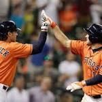 Grossman blasts Astros past Rangers