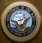 Third Navy official charged in bribery case