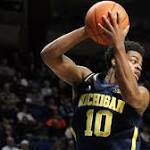 Michigan holds off Penn State with clutch free throws