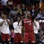 Dwyane Wade dances alongside Vanilla Ice at Miami Heat's Family Festival