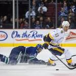 Canucks fall to Predators, 3-1, lose two players