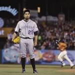 De La Rosa serves up slam to pitcher, Rockies lose