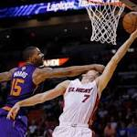 Dragic scores 21, Heat beat Suns 115-98 as tensions run high