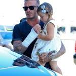 David Beckham sports bandaged arm after motorbike crash as he carries ...