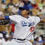 Dodgers, A's play to 8-8 tie in nine innings