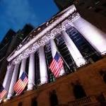 US stocks end see-saw day lower; Oil remains volatile