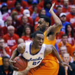 Joel Embiid shines as No. 15 Kansas slips by No. 9 Oklahoma State