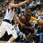 No headband, no problem as LeBron James helps Cavaliers rout Mavs