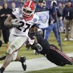 Lauren Brownlow: Four Downs: Georgia runs past Louisville to win Belk Bowl