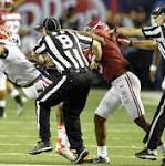NCAA votes to try centralized replay, review 'all aspects' of targeting