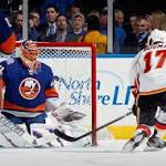 Halak saves penalty, sets Isles record in win over Flames