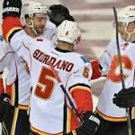Byron nets 2, Flames beat Coyotes 5-3