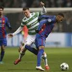 Messi double guides Barcelona to 2-0 win at Celtic