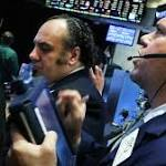 Stocks slide with oil; triple-digit losses for Dow
