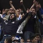 Atletico Madrid defeats Deportivo 2-0 amid sorrow over fan's death