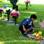 Cub Scouts place flags on the graves of Central Florida veterans
