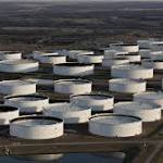 Oil drops as US inventories surge still higher