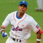 Dodgers sign Cuban free agent Hector Olivera to $62.5 million deal