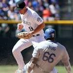 Dodgers rally in the 9th, defeat Rockies, 12-10