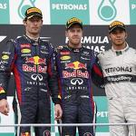 Vettel wins controversial battle against Webber