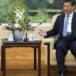 President Xi Jingping meets John Howard as diplomatic tensions rise