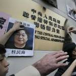 Hong Kong bookseller's disappearance sparks protests at Beijing office