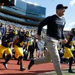 Jim Harbaugh says new glasses a nod to Woody Hayes, Malcolm X