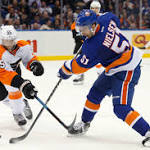 Isles win fourth straight, top Flyers in shootout