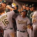 Céspedes crushes 2 homers as A's win 6-3