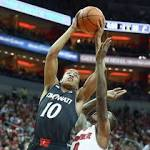 College Basketball: Cincinnati knocks off No. 12 Louisville