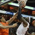 No. 12 Louisville holds off tough Miami challenge