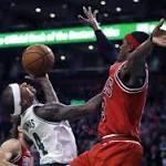 Thomas, Johnson help lead Celtics past Bulls, 107-100