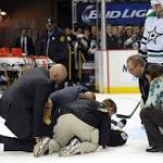 Penguins' Pascal Dupuis leaves game on stretcher