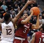 UConn men close 2014 with OT loss to Temple, injury to Ryan Boatright