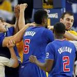 Warriors show true grit in whipping Clippers