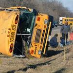 Man dead, 20 students hurt after car, school bus collide