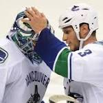 Defense helps lead Canucks over Blues