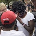 The Latest: People rally in Baltimore to protest violence