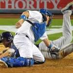 WISCONSIN SPORTS ROUND-UP: Big eighth inning lead Brewers to win