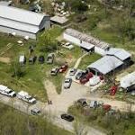 Manhunt, mystery follow Ohio bloodbath