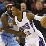 Hot-shooting Kings rout Nuggets
