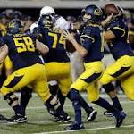 No. 22 Northwestern beats Cal 44-30 in opener