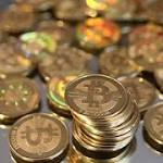 Bitcoin juggles promise and problems as a currency and payment system