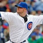 With ball stuck, Jon Lester tosses mitt to first base to get out