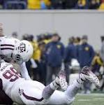 Allen leads Aggies past WVU 45-37 in Liberty Bowl