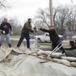 Mississippi River towns on high alert even as flooding forecast improves
