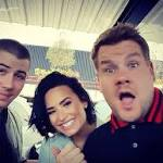 Watch James Corden and Demi Lovato Grill Nick Jonas About Dating Miley Cyrus and Selena Gomez on Carpool ...