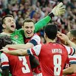 Wigan 1 Arsenal 1; Arsenal win 2-4 on pens: match report