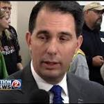 Walker signs agreement with Alzheimer's researchers, meets with Merck ...