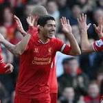 Luis Suarez double helps Liverpool shoot to top of Premier League with 3-1 win ...